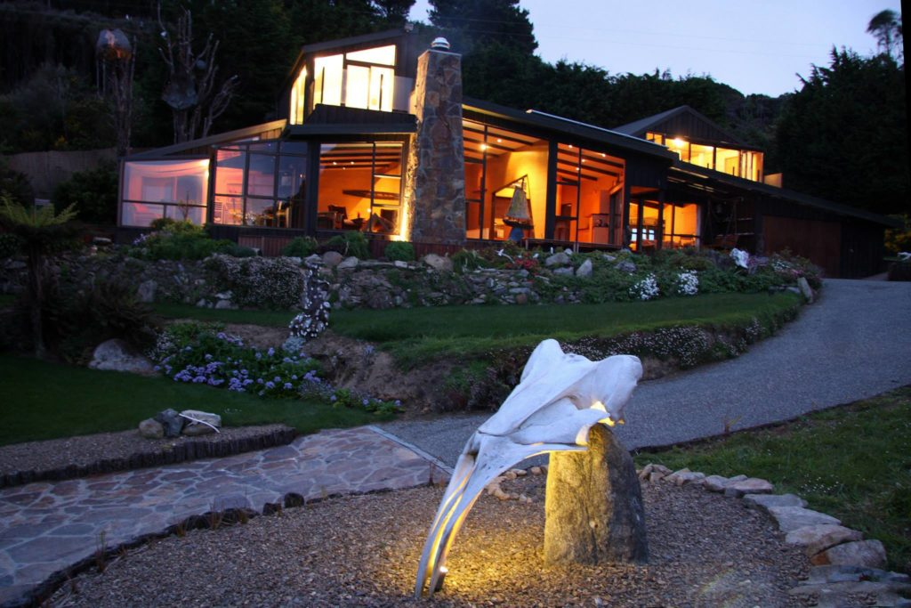 Jensen Bay House Accommodation with lights on at night